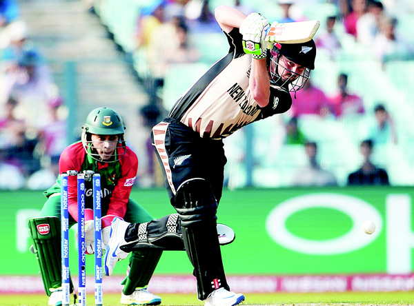 New Zealand's Colin Munro plays a shot during the World T20 cricket tournament match between Bangladesh and New Zealand at The Eden Gardens Cricket Stadium in Kolkata on March 26. (AFP)
