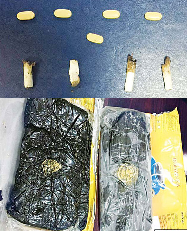 Pills and cigarettes found on the 2 citizens (below) Two kilos of hashish seized from the GCC citizen