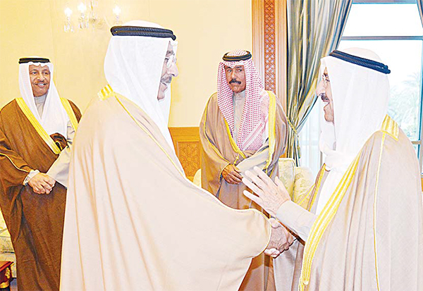 Al-Jassar being congratulated by HH the Amir after the oath-swearing ceremony