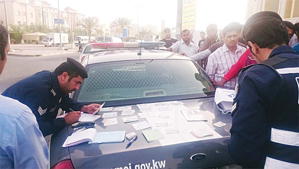 Securitymen checking the IDs and driving documents of some expats