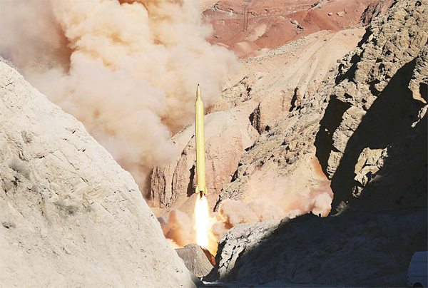 In this photo obtained from the Iranian Fars News Agency, a Qadr H long-range ballistic surface-to-surface missile is fi red by Iran's Revolutionary Guard, during a maneuver, in an undisclosed location in Iran, on March 9. Iran's powerful Revolutionary Guard test-fi red two ballistic missiles Wednesday with the phrase 'Israel must be wiped out' written on them, a show of deterrence power by the Islamic Republic as US Vice-President Joe Biden visited Israel, the semi-offi cial Fars News Agency reported. (AP)