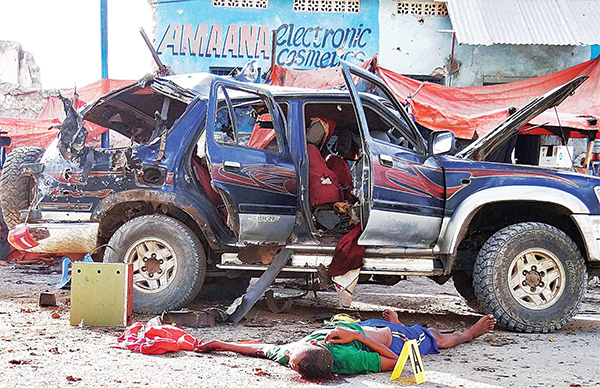 This file photo shows the scene of a car bomb attack which killed at least three police officers outside a tea shop near the police transport headquarters in Mogadishu, Somalia. (AFP)