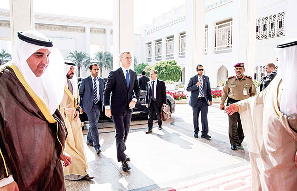In this photo made available by NATO, Secretary General of NATO Jens Stoltenberg (center), arrives at the Amir's Palace in Kuwait to meet with officials, Feb 29. (AP)