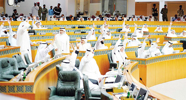 MPs raise their hands during a parliamentary session in Kuwait City on March 29. Lawmakers on Tuesday endorsed amending Law No. 69/2015 regarding the establishment of a shareholding company to bring in domestic help from abroad and turned over the amended version to the government for final perusal.