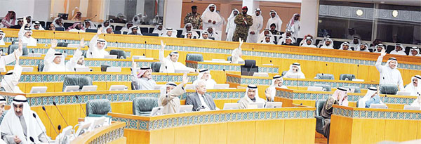 Members of Parliament voting on an issue in Tuesday's parliamentary session.