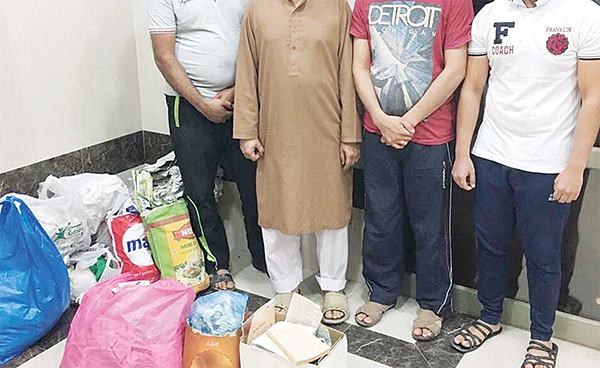 The four Pakistanis arrested for practicing sorcery.