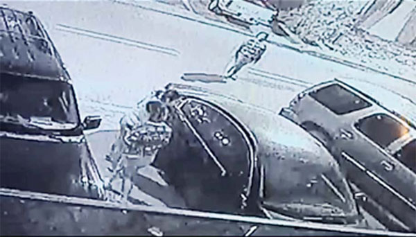 Photo from video clips showing the girls breaking into the cars