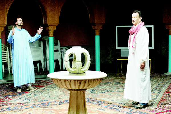This image released by the Roadside Attractions shows Alexander Black (left), and Tom Hanks in a scene from 'A Hologram for the King', a film being featured at the Tribeca Film Festival. (AP)