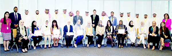 Hamza Enki (GM Human Resources) and Stewart Lockie (GM Retail Banking) with the 18th group of ABK Academy graduates.
