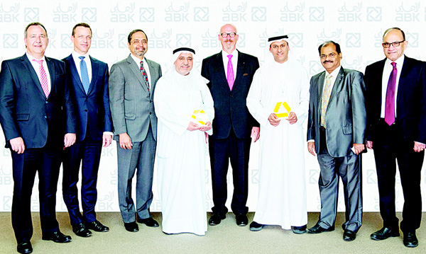 Somnath Menon (Chief Operating Officer, ABK), Karl Stumke (GM, ABK) and ABK officials receiving the STP Award from Michael Gehrmann (Commercial Bank) and Andreas Scheer (Commerzbank)