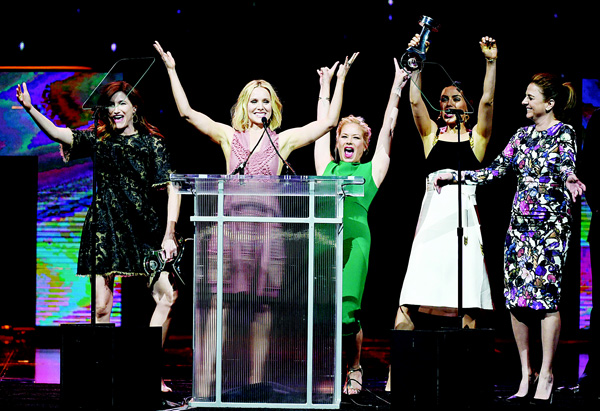 (Left-right): Actresses Kathryn Hahn, Kristen Bell, Christina Applegate, Mila Kunis and actress/screenwriter Annie Mumolo accept the Female Stars of the Year Award during the cinemacon Big Screen Achievement Awards brought to you by the Coca-Cola Company at The Colosseum at Caesars Palace during CinemaCon, the official convention of the National Association of Theatre Owners, on April 14, in Las Vegas,  Nevada. (AFP)