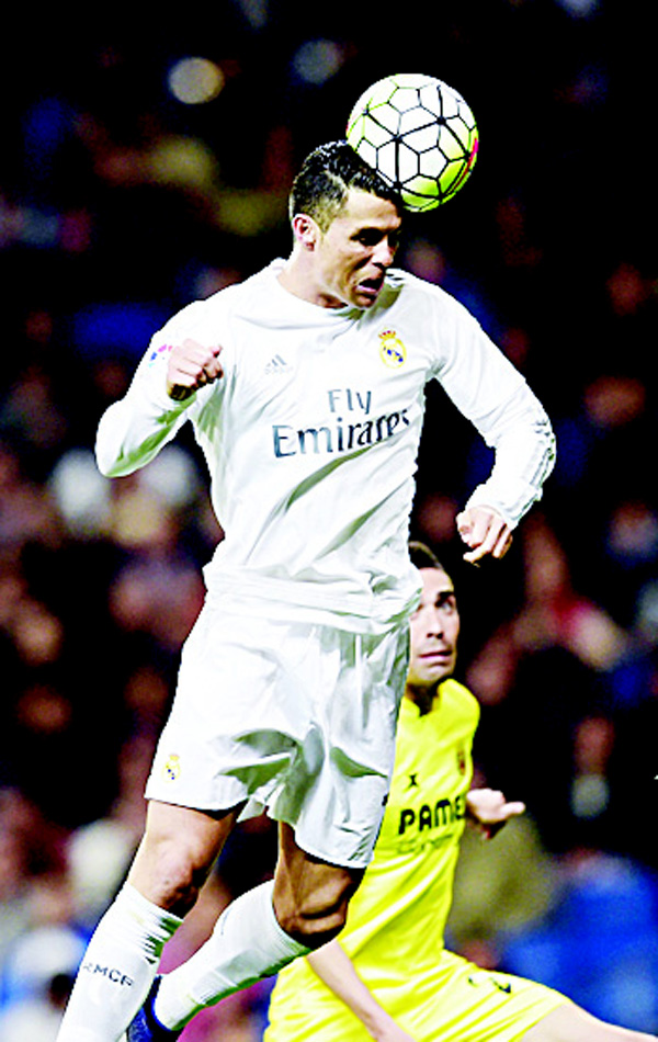 Real Madrid's Portuguese forward Cristiano Ronaldo heads the ball during the Spanish league football match Real Madrid vs Villarreal at the Santiago Bernabeu Stadium in Madrid on April 20. (AFP)