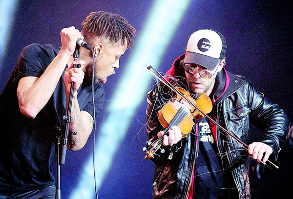 Ashley MacIsaac (right) performs with his band Neon Dreams to open the 2016 East Coast Music Awards Gala on April 14, in Sydney, NS, Canada. (AP)
