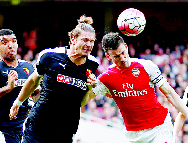 Watford's Austrian defender Sebastian Prodl (left), vies with Arsenal's French defender Laurent Koscielny during the English Premier League football match between Arsenal and Watford at the Emirates Stadium in London on April 2. (AFP)