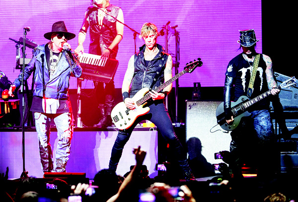 In this April 23, 2014 file photo, Axl Rose (from left), Duff McKagan and DJ Ashba of Guns N' Roses perform on stage at the 6th Annual Revolver Golden Gods Award Show at Club Nokia in Los Angeles. (AP)
