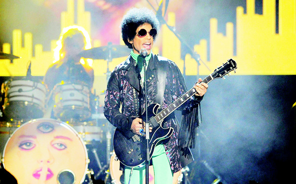 In this May 19, 2013 file photo, Prince performs at the Billboard Music Awards at the MGM Grand Garden Arena in Las Vegas. Tickets for what turned out to be Prince's last concert, in Atlanta, went on sale just eight days before he was scheduled to play and sold out almost instantly. (AP)