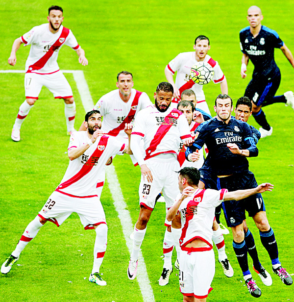 Real Madrid's Gareth Bale (center right), jumps for a high ball during a Spanish La Liga soccer match between Rayo Vallecano and Real Madrid at the Vallecas Stadium in Madrid, Spain, on April 23. (AP)
