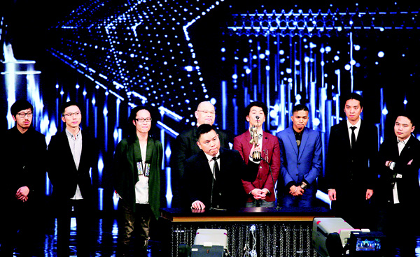Hong Kong producer Andrew Choi (front), raises the trophy after winning the Best Film Award for his movie 'Ten Years' at the 35th Hong Kong Film Awards in Hong Kong on April 3. (AP)