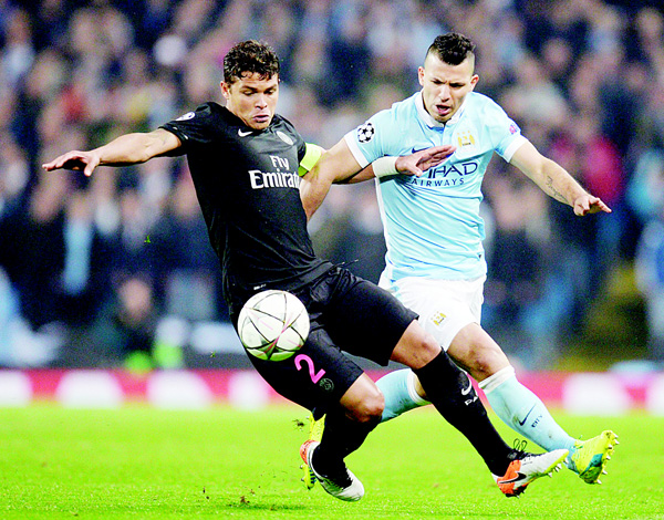 Paris Saint-Germain's Brazilian defender Thiago Silva (left), vies with Manchester City's Argentinian striker Sergio Aguero during the UEFA Champions League quarter-final second leg football match between Manchester City and Paris Saint-Germain at the Etihad Stadium in Manchester on April 12. (AFP)