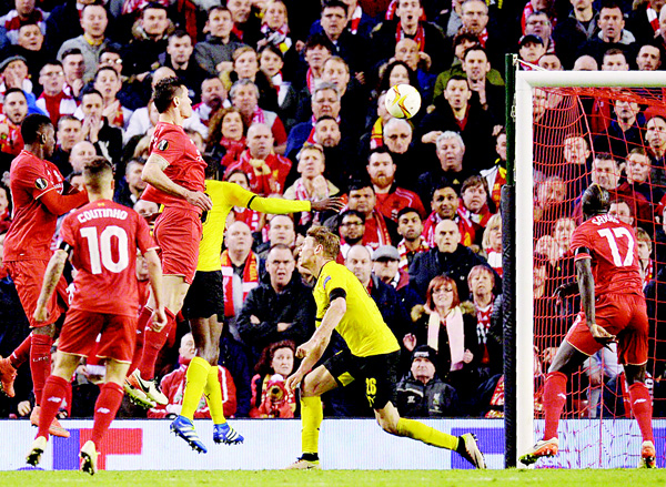 Liverpool's Croatian defender Dejan Lovren (3rd left), heads the ball to score the winning goal during the UEFA Europa League quarter-final second leg football match between Liverpool and Borussia Dortmund at Anfield Stadium in Liverpool on April 14. (AFP)