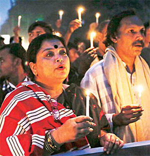 In this Dec 14, 2015 file photo, Bangladeshi people hold lighted candles and walk in a rally during Martyrs Day in Dhaka, Bangladesh. The slaying in Bangladesh of a US Agency for International Development employee has intensified US concern that the strategically located South Asian country with traditions of religious tolerance is under threat from Islamic extremists. (AP)