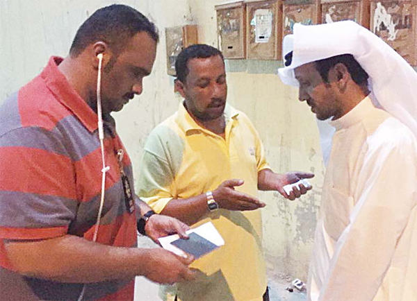 Securitymen check documents of a fisherman