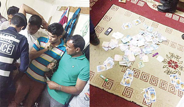 Left: Securitymen raid the gambling den, and (right) cash seized from the place