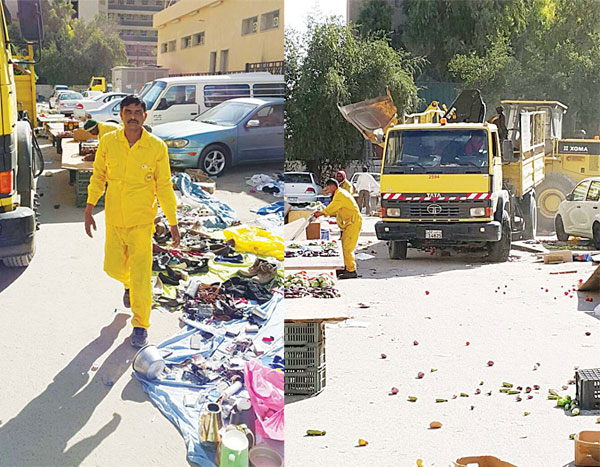 Municipality workers confiscate the goods and eatables put on sale in Mahboula