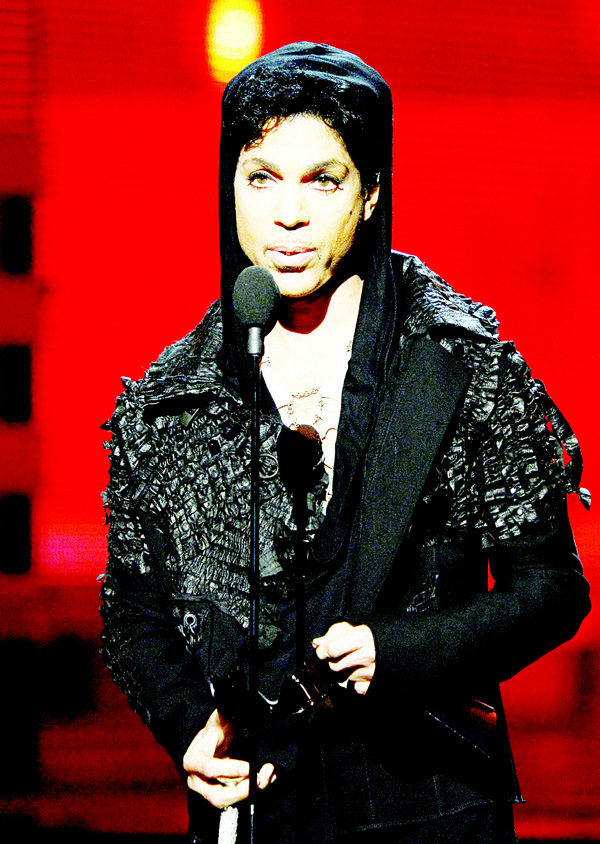 In this file photo, musician Prince speaks onstage at the 55th Annual Grammy Awards at Staples Center on Feb 10, 2013 in Los Angeles, California. Pop icon Prince — one of the most influencial but elusive figures in music — has died at his compound in Minnesota, entertainment website TMZ reported on April 21, citing unnamed sources. Local authorities said a death investigation was underway at Prince's Paisley Park Complex, but did not give the identity of the fatality. (AFP)