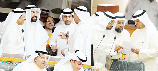 Parliamentarians in discussion prior to Wednesday's National Assembly session.