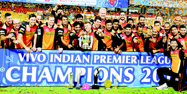 Sunrisers Hyderabad team pose for a photograph as the players celebrate their victory against Royal Challengers Bangalore after the trophy presentation in the final Twenty20 cricket match of the 2016 Indian Premier League (IPL) between Royal Challengers Bangalore and Sunrisers Hyderabad at The M Chinnaswamy Stadium in Bangalore on May 29. (AFP)