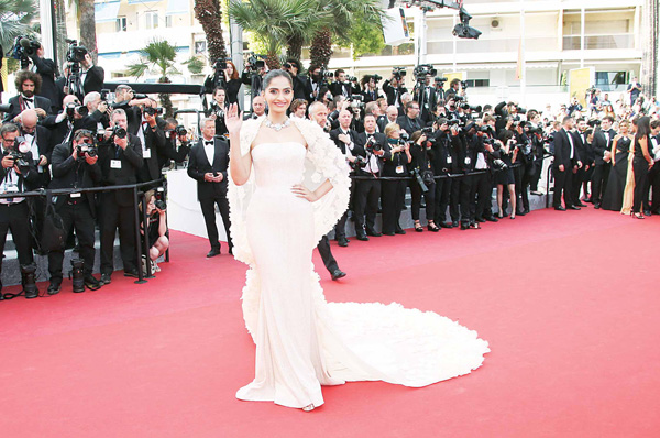 Actress Sonam Kapoor poses for photographers upon arrival at the screening of the film 'Loving' at the 69th international film festival in Cannes, southern France on May 16. (AP)
