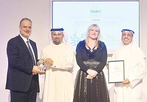 Michel Accad (CEO-ABK) and Fawzy Al Thunayan (GM Board Affairs — ABK) receiving 'Best Commercial Bank in Kuwait' Award and 'Banker of the Year' Award by Banker Middle East.