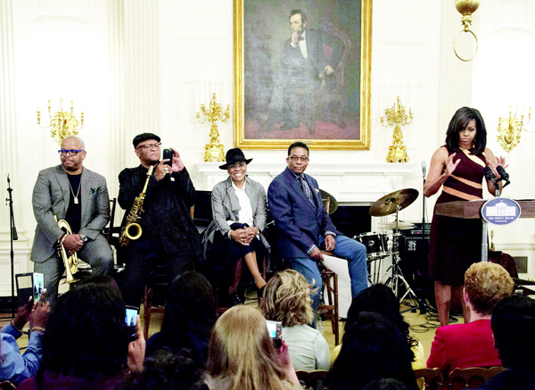 US First Lady Michelle Obama (right), shares the stage with (from left to right) trumpet player Terrence Blanchard, saxophonist Bobby Watson, vocalist Dee Dee Bridgewater and pianist Herbie Hancock as she addresses an audience of high school students during the History of Jazz Student Workshop at the White House as part of the International Jazz Day celebration in Washington, DC on April 29. (AFP)