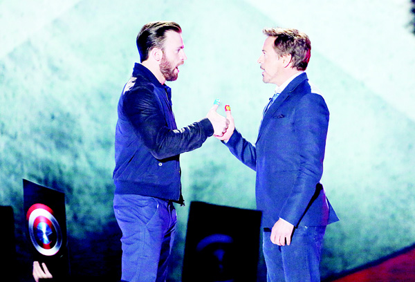 In this March 12, 2016, file photo, Chris Evans (left), and Robert Downey Jr play thumb war at the Kids' Choice Awards at The Forum in Inglewood, Calif. (AP)