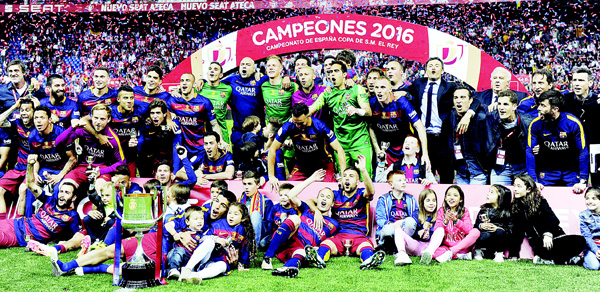 Barcelona team pose for a photo as they celebrate after winning the Spanish 'Copa del Rey' (King's Cup) final match FC Barcelona vs Sevilla FC at the Vicente Calderon Stadium in Madrid on May 22. (AFP)
