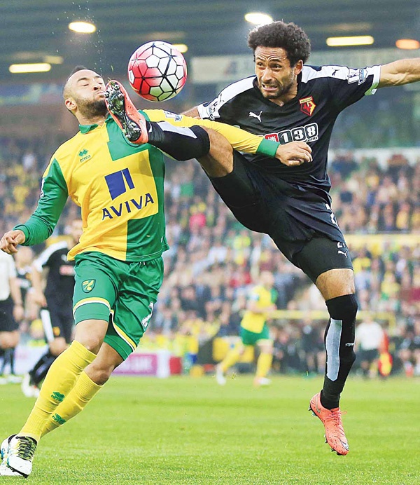 Norwich City's Nathan Redmond (left), and Watford's Ikechi Anya battle for the ball during the English Premier League soccer match at Carrow Road, Norwich, England, on May 11. (AP)