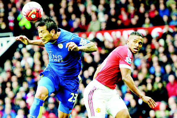 Leicester City's Argentinian striker Leonardo Ulloa (left), beats Manchester United's Ecuadorian midfielder Antonio Valencia (right), to head the ball during the English Premier League football match between Manchester United and Leicester City at Old Trafford in Manchester, north west England, on May 1. (AFP)