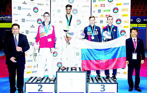 In this May 19, 2016 picture Spain's Jesus Tortosa Cabrera, silver, Belgium's Mourad Laachraoui, gold, Russia's Stanislav Denisov and Mikhail Artamonov, both third place (from left to right), pose on the podium after the men 54-kg finals at the European Taekwondo Championships in Montreux, Switzerland. (AP)