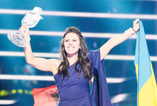 Jamala representing Ukraine with the song '1944' celebrates with the trophy after winning the final of the Eurovision Song Contest 2016 Grand Final in Stockholm, on May 14. (AFP)