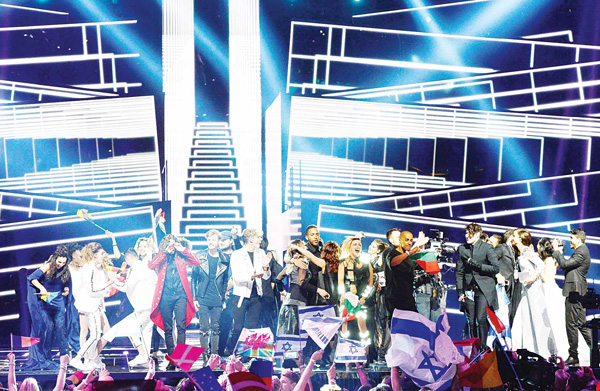 Singers and delegations celebrate as they advance to the grand final, after qualifying in the second semifinal of the Eurovision Song Contest 2016 in Stockholm, Sweden, on May 12. (AFP)