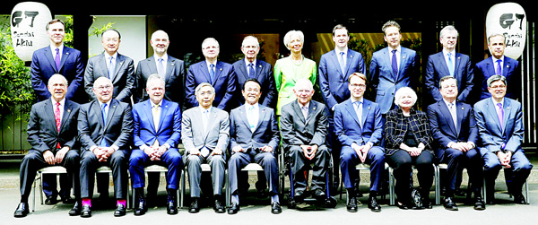 Japanese Finance Minister Taro Aso (fifth from left in front row), poses with other finance ministers and heads of central banks of the Group of Seven for a group photo in Akiu, northern Japan on May 21. The G7 major economies showed a united front on fighting terrorist financing and tax evasion in talks that ended Saturday, but shied away from coordinated action on policies to revive stalling growth. (AP)