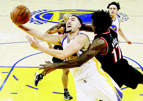 Golden State Warriors guard Klay Thompson (front left), is fouled by Portland Trail Blazers center Ed Davis while scoring during the second half in Game 1 of a second-round NBA basketball Playoff Series in Oakland, California on May 1. (AP)