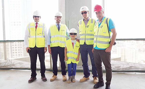 Maher posing with project engineers at the construction site of new NBK Head Quarters