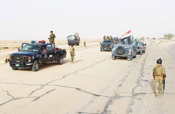 Iraqi government forces gather on the highway between the city of Ramadi and the town of Rutba as they prepare to take  art in an operation to retake Rutba from the Islamic State jihadist group on May 16. Special forces, soldiers, police, border guards and pro-government paramilitaries are involved in the operation to retake the Anbar province town, which has been held by the jihadist group since 2014, Iraq's Joint Operations Command said. (AFP)