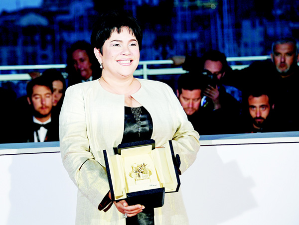 Filipino actress Jaclyn Jose poses after she was awarded with the Best Actress prize on May 22, during a photocall at the 69th Cannes Film Festival in Cannes, southern France. (AFP)