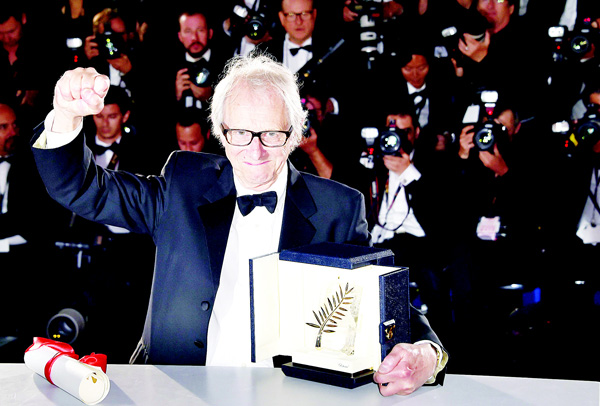 British director Ken Loach poses with his trophy on May 22, during a photocall after winning the Palme d'Or for the film 'I, Daniel Blake' at the 69th Cannes Film Festival in Cannes, southern France. (AFP)