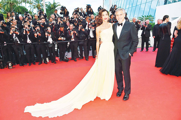 US actor George Clooney (right), and his wife British-Lebanese lawyer Amal Clooney pose on May 12, as they arrive for the screening of the film 'Money Monster' at the 69th Cannes Film Festival in Cannes, southern France. (AFP)