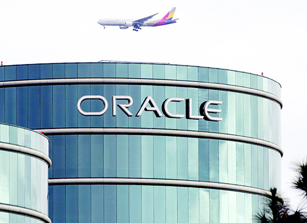 In this file photo, a plane flies over Oracle headquarters in Redwood City, Calif. On May 26, a federal jury sided with Google in a long-running legal battle with tech industry rival Oracle in a complex copyright case that was closely watched in Silicon Valley. (AP)