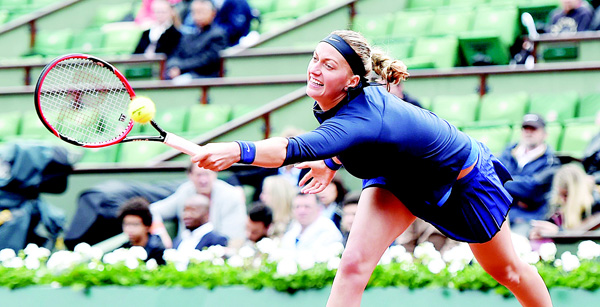 Czech Republic's Petra Kvitova hits a forehand to Montenegro's Danka Kovinic during their first round match at the Roland Garros 2016 French Tennis Open in Paris on May 22. (AFP)